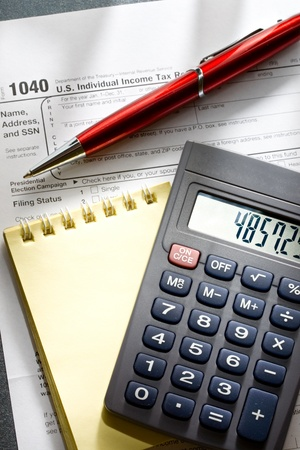 Tax form, red pen, notepad and calculator Stock Photo - 11293160