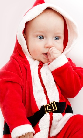 Baby in santa-costume on a white background photo