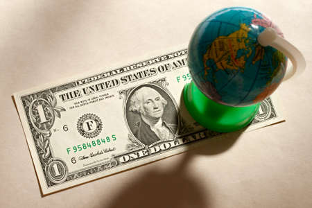 Terrestial globe and one dollar photo