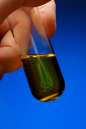 Hand holding a test tube with liquid photo