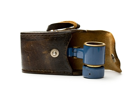 Binoculars with a case on white photo