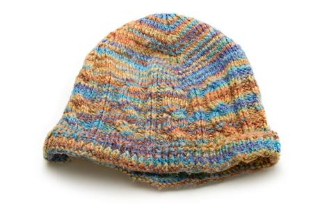 knitten: A motley cap on white Stock Photo