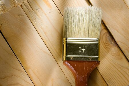 Brush on a wooden background  photo
