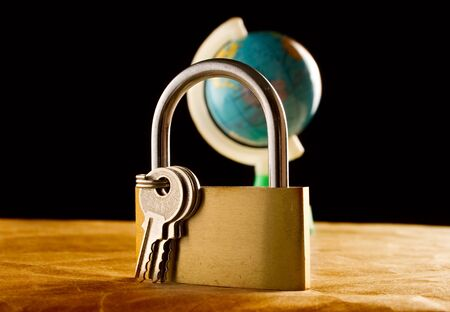keylock: Globe and the keylock Stock Photo