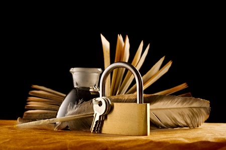 keylock: A feather, inkpot, old book and keylock