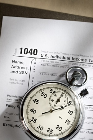 Tax form and stopwatch photo