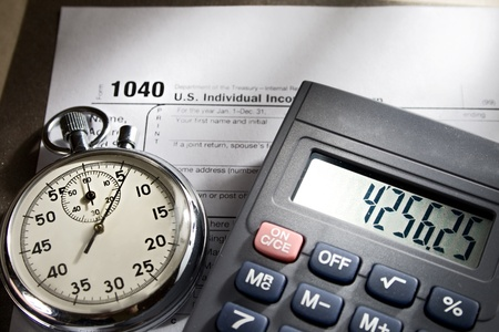 refund: Tax form, stopwatch and calculator