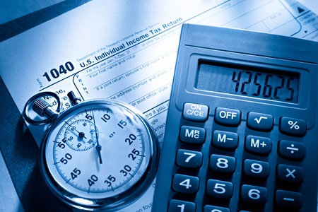 tax law: Tax form, stopwatch and calculator