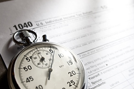 tax forms: Tax form and stopwatch