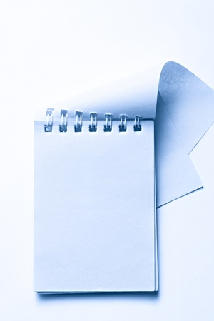 Notepad on the white background photo