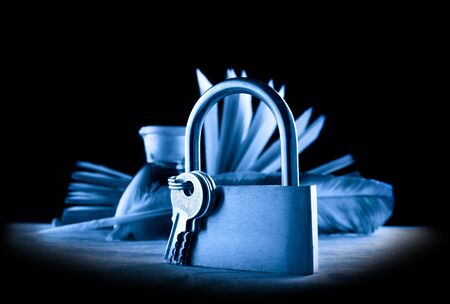 keylock: A feather, inkpot, old book and keylock in blue