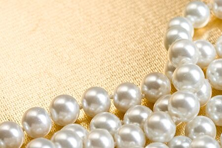 String of pearls on golden surface Stock Photo - 12078404