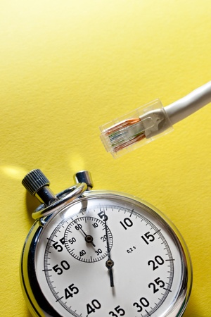 cable and stopwatch on yellow photo