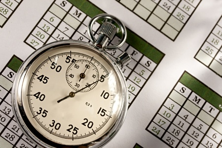 transience: Monthly calendar and stopwatch Stock Photo