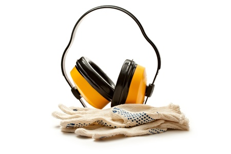 Headphones and pair of working gloves photo