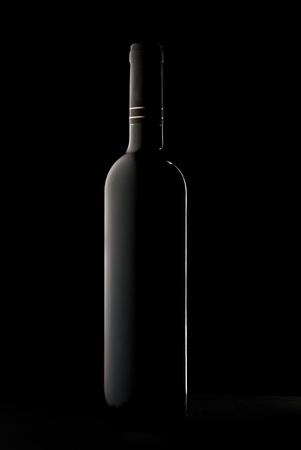 alcohol bottle: Bottle of wine in black Stock Photo