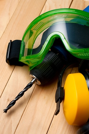 Handdrill, earphones and goggles photo