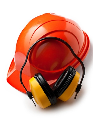 protective wear: Red safety helmet with earphones Stock Photo