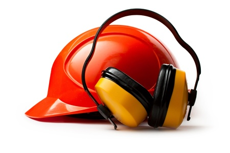 personal protective equipment: Red safety helmet with earphones Stock Photo