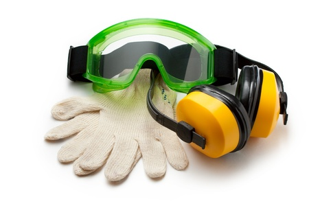 safety glasses: Green goggles with gloves and earphones Stock Photo