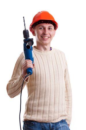 casco rojo: Trabajador en el casco rojo con un taladro