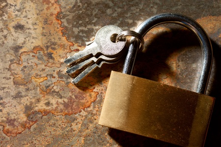 Lock with keys on the rusty background Stock Photo - 12752958