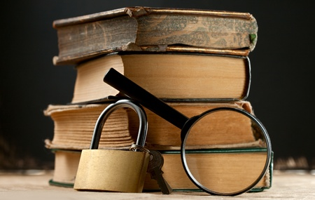 keylock: Old books with keylock and magnifying glass Stock Photo