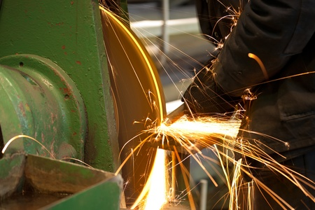 Emery in process in machinery workshop