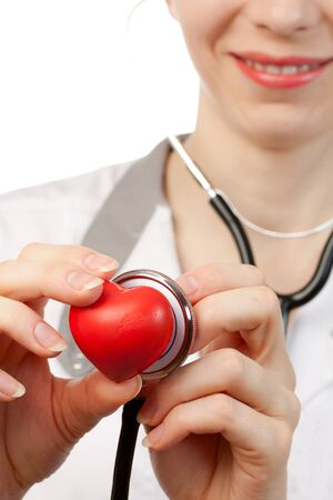 Woman doctor with stethoscope and heart photo