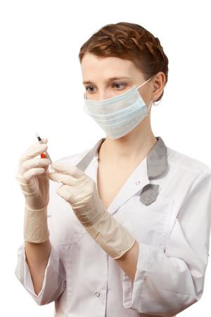 medical mask: Enfermera en guantes est�riles y mascarilla m�dica Foto de archivo