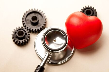 simultaneous: Mechanical ratchets, stethoscope and red heart