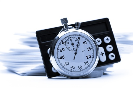 Pile of paper cards, calculator and stopwatch Stock Photo - 12953060