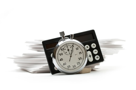 Pile of paper cards, calculator and stopwatch photo