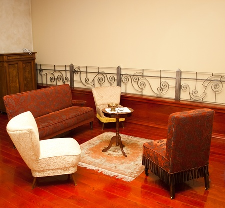Old fashion sitting room with sofa photo