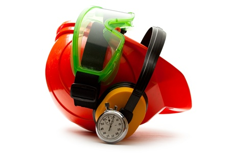 Red safety helmet with earphones, goggles and stopwatch photo
