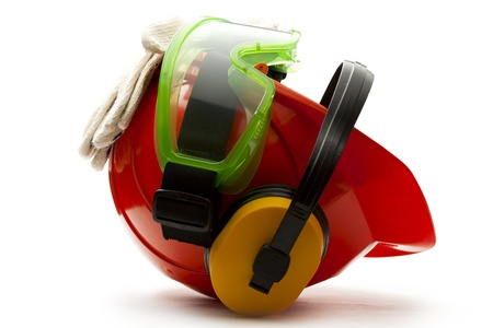 personal protective equipment: Red safety helmet with earphones, goggles and gloves Stock Photo