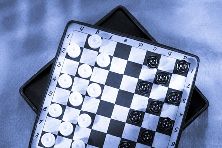 Travelling draughts on playing field  photo