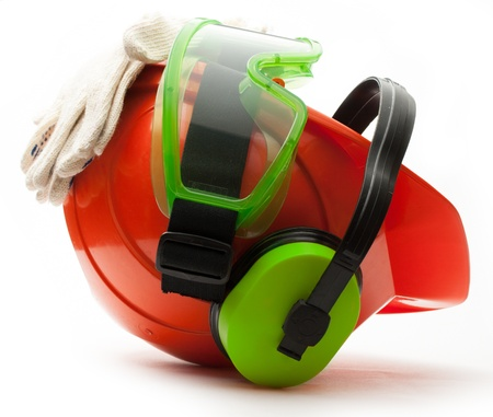 Red safety helmet with earphones, goggles and gloves photo