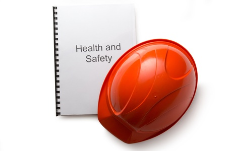 Health and safety register with helmet Stock Photo