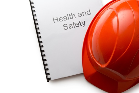 work safety: Health and safety register with helmet Stock Photo