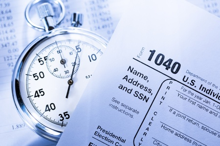 income tax: Tax form, operating budget and stopwatch Stock Photo