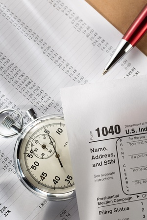 Tax form, operating budget and stopwatch photo