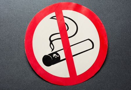 No smoking sign on background photo