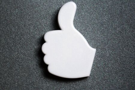 Thumb up okay sign badge photo