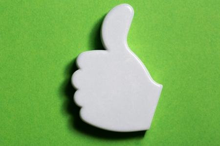 Thumb up okay sign badge photo
