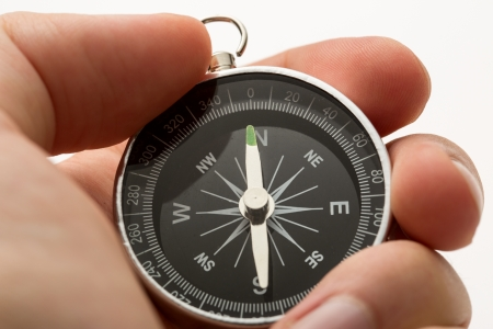 Hand holding silver black compass Stock Photo - 14933675