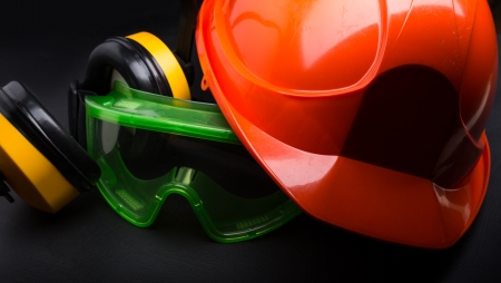 safety glasses: Red safety helmet with earphones and goggles