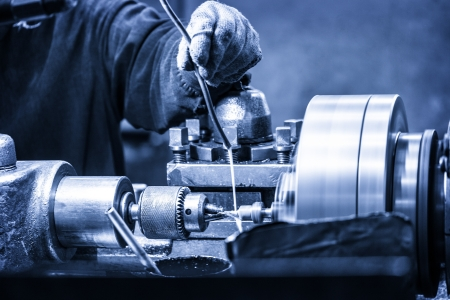 Turning lathe in the workshop in blue Stock Photo
