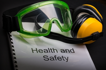 Health and safety register with goggles and earphones  Stock Photo