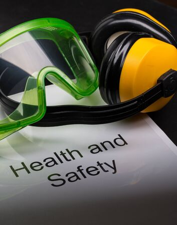 eyeshield: Health and safety register with goggles and earphones  Stock Photo